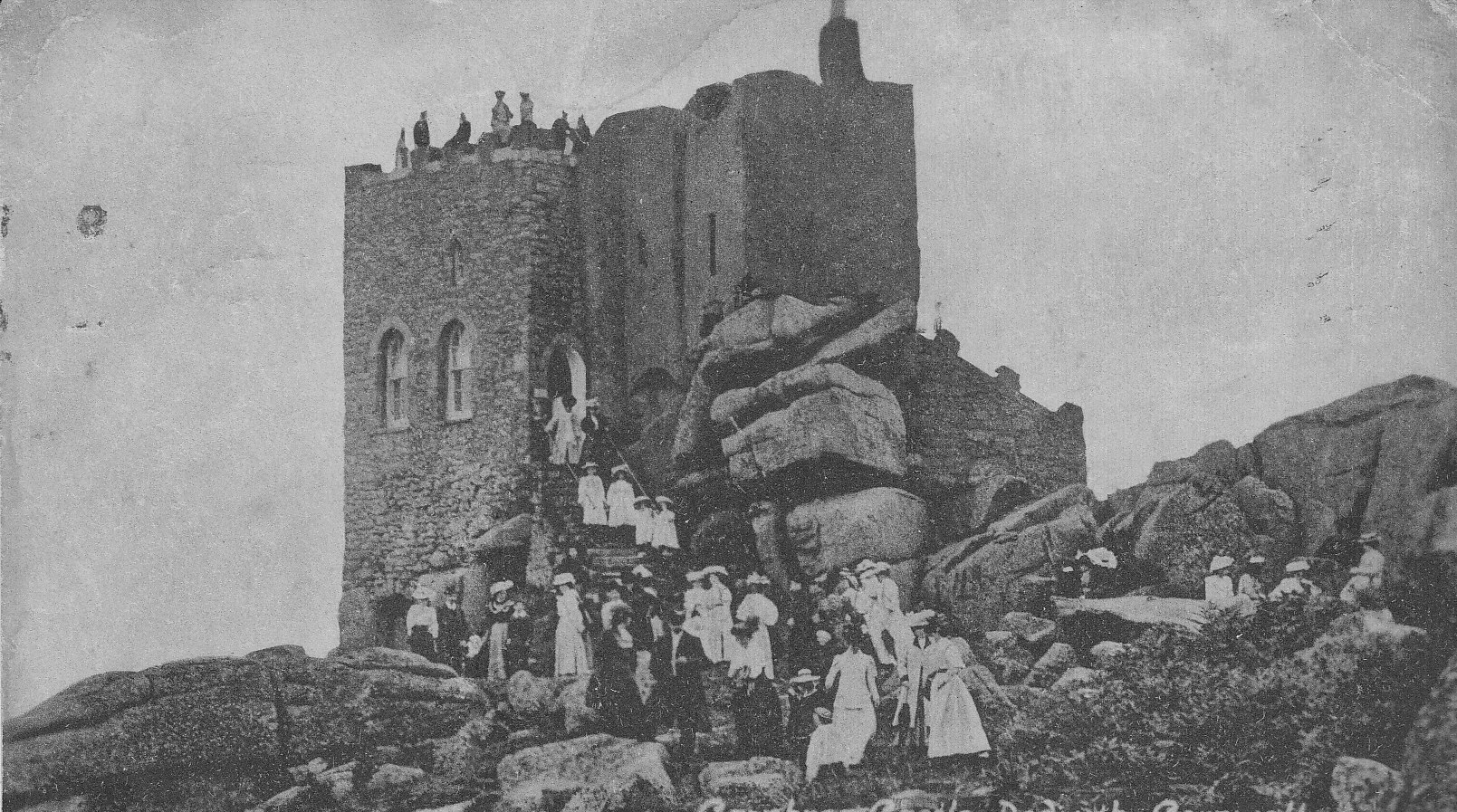 carn brea castle with people